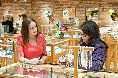 Silverado employee Rachel Schulman (Left) helps Ellen O'Rourke pick out jewelry during the Black Friday sales in Saratoga Springs. Photo Eric Jenks 11/26/10