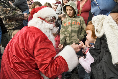Saratoga Skydiving Santa Claus gives a candy cane to Anna Caccamo at Ellms Christmas Tree farm Saturday afternoon. Photo Eric Jenks 11/26/11