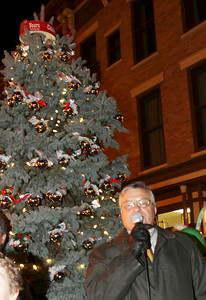 Downtown Business Association President Jeff Clark welcomes guests during Wednesday's tree-lighting. John R. Dillon photo 11/30/11