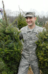 Sgt. Jason Wells helped load the FedEx Truck full of trees from local farms at Ellms Farm Monday morning. The troops and other loaded 115 trees for Trees For Troops and Christmas Spirit Foundation. Photo Erica Miller 11/28/11 news_TreesTroops3_Tues