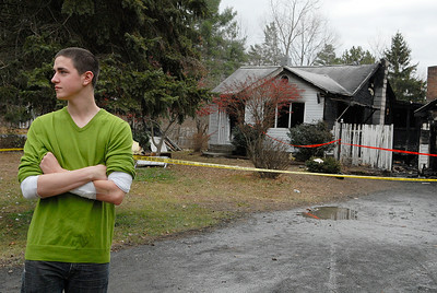 Raleigh Powell, 20 years-old, stands in front of the home at 267 Lapp Road where a fire broke out Sunday evening and he braved the fire by breaking into the house to save a dog and the owner's wife. Photo Erica Miller 11/28/11 news_RaleighPowell1_Tues