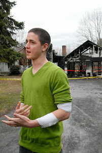 Raleigh Powell, 20 years-old, stands in front of the home at 267 Lapp Road where a fire broke out Sunday evening and he braved the fire by breaking into the house to save a dog and the owner's wife. Photo Erica Miller 11/28/11 news_RaleighPowell3_Tues