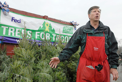 Chip Ellms spoke briefly before they loaded the FedEx Truck full of trees from local farms at Ellms Farm Monday morning. The troops and other loaded 115 trees for Trees For Troops and Christmas Spirit Foundation. Photo Erica Miller 11/28/11 news_TreesTroops2_Tues