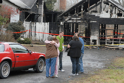 Neighbors consoles with family members children as Raleigh Powell, 20 years-old, and his mother Christina Cole are on scene in front of the home at 267 Lapp Road where a fire broke out Sunday evening and he braved the fire by breaking into the house to save a dog and the owner's wife. Photo Erica Miller 11/28/11 news_RaleighPowell5_Tues