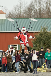 With a little help from Saratoga Skydiving, Santa Claus drops in on the crowd at the Ellms Christmas Tree Farm in Ballston Spa Saturday afternoon. Photo Eric Jenks 11/26/11