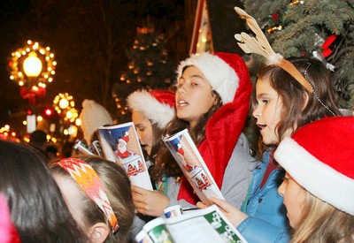 Girl Scouts sing holiday songs while waiting for Sant to arrive. John R. Dillon photo