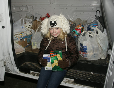 Nine year old Abigail McCarthy sits with food donations for the Saratoga County EOC brought by people who came to see CP's holiday train. Abigail is the daughter of EOC employee Lillian McCarthy. Ed Burke 11/29/12