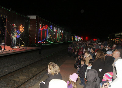 People line the tracks as The Claytones perform aboard Canadian Pacific's holiday train Thursday night at the Saratoga Springs train station. Ed Burke 11/29/12