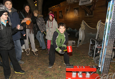 Strongman Jack Kavanagh of Saratoga tests his strength at the Saratoga Chabad Noah's Ark display. Ed Burke 11/29/12