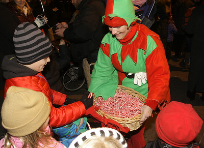 Saratoga Chrysler Jeep Dodge elve Karen Naja hands out candy canes. Ed Burke 11/29/12