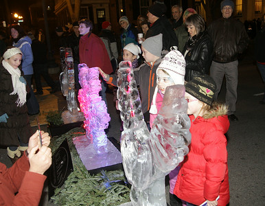 Children admire ice sculptures. Ed Burke 11/29/12