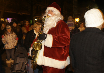 Saxophone Santa plays for the crowd. Ed Burke 11/29/12