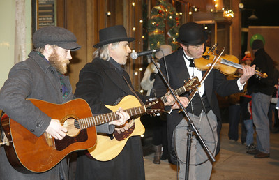 Johnny Kribs performs with son Orion at left and fine fiddler Doug Moody. Ed Burke 11/29/12