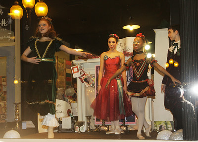 Members of the Northeast Ballet perform in the window at Paper Dolls. Ed Burke 11/29/12