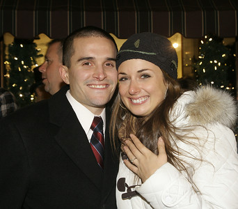 Justin Grassi and Jennifer Laskey celebrate after getting engaged during the Victorian Streetwalk. Ed Burke 11/29/12