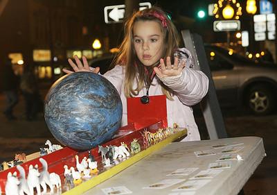 Seven year old Alayna Wian of Schuylerville plays a ball rolling game at Saratoga Chabad's Noah's Ark display. Ed Burke 11/29/12
