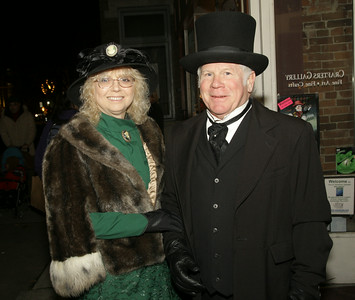 Author Hollis Palmer and Sandy Graff dress the part for Thursday's Victorian Streetwalk. Ed Burke 11/29/12