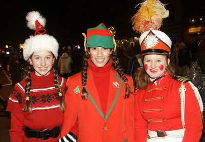 Santa's elves from left: Paige Benfer, Sophia Burke and Alla Dalton. Ed Burke 11/29/12