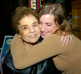 Jennifer Poitras, right, hugs Naomi Baker, mother of Gaffney's owner John Baker during a benefit Wednesday for Poitras at Gaffney's where she has worked for the last twenty years. Friends and family came together for the evening to help raise money for Poitras who is battling cancer. Ed Burke 10/28/09
