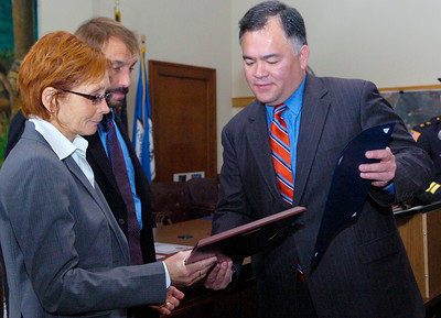 Public Safety Commissioner Ron Kim hands over a plaque to Linda Kranick and Art Kranick after helping to save one of their runners lives, Lindsey Ferguson on October 31st, 2005, with the help of fellow teacher Ray Harrington (not shown). held at the Saratoga City Hall Thursday afternoon. Photo Erica Miller 10/29/09 news_PDawards2_Fri