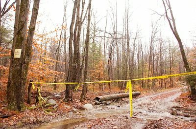 Caution tape at the possible crime scene where skeleton parts were found in the woods off Fox Hill Road near Lake Desolation.  Photo Erica Miller 10/28/09 news_CrimeScene_Thurs