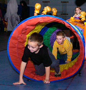 Students from the Wood Road Elementary climb through the Fun Day obstacle Course all day in celebration of Halloween with scary music and themes in Ballston Spa Friday afternoon. Photo Erica Miller 10/30/09 news_Halloween3_Sat