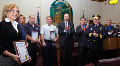 Saratoga Emergency Corps members receive awards for aiding to Saratoga Police officer Adam Baker after his throat was slashed September 5th, 2007, held at the Saratoga City Hall Thursday afternoon. Photo Erica Miller 10/29/09 news_PDawards1_Fri