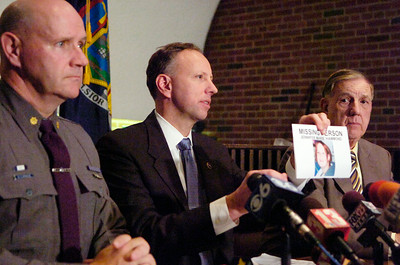 Saratoga County DA James Murphy holds up the photograph of the missing person found out near Lake Desolation, Jennifer Marie Hammond with Major Bill Sprague and Sheriff Jim Bowen (right). Photo Erica Miller news_missing1_Fri