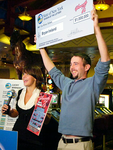 Recent NYS Lottery Winner of One Million Dollars Bryan Ireland, of South Glens Falls, holds up his check with NYS Lottery drawings personality Gretchen Dizer at the Saratoga Gaming and Raceway. Photo Erica Miller 10/29/09 news_Million1_Fri