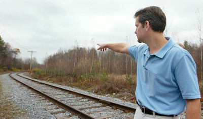 GM of Hillcrest Foods Inc. points to the area where the trains stop and then get routed into their Distribution Center to drop off their deliveries, a new system started to lower cost production and the use of fossil fuels. Photo Erica Miller 10/30/09 news_Hillcrest4_Sat