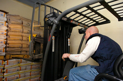 Lane Vincent II, warehouse worker for Hillcrest Foods Inc., takes off a load from their most recent delivery train containing 160 thousand pounds and 3400 bags of wholesale products to be sold.  Photo Erica Miller 10/30/09 news_Hillcrest2_Sat
