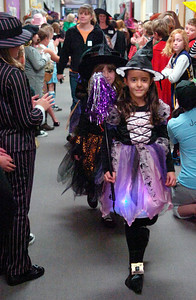 Students from Milton Terrace South, Ballston Spa, Elementary parade down their hallways in celebration of Halloween showing off their creative costumes Friday afternoon. Photo Erica Miller 10/30/09 news_Halloween7_Sat