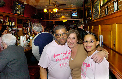 Jennifer Poitras stands with husband Ricci Nelson and their daughter Jovanna, age 14, during a fundraiser at Gaffney's Wednesday for Poitras who battling cancer. Frienda and family turned out to support and raise money forr Poitras who has worked at Gaffney's for twenty years. Ed Burke 10/28/09