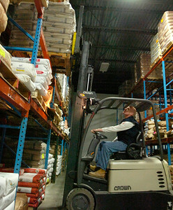 Lane Vincent II, warehouse worker for Hillcrest Foods Inc., takes off a load from their most recent delivery train containing 160 thousand pounds and 3400 bags of wholesale products to be sold.  Photo Erica Miller 10/30/09 news_Hillcrest3_Sat