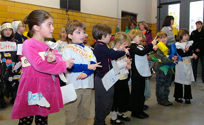 Students from the Saratoga Independent School, ages 6-10, sang to the Saratoga Springs Fire Department as they were dressed up in vocabulary words. The students had the chance to get a tour of the Fire Department as well as thank them for their hard work and dedication to the city with bags of candy for Halloween. Photo Erica Miller 10/30/09 news_SIScandy1_Sat