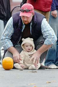 Gary Fleury and 6 month old Owen of Ballston Spa roll a pumpkin down Caroline Street for the Pumpkin rolling contest at the annual Fall Festival Saturday morning. Photo Erica Miller 10/30/10 fea_FallFest7_Sun