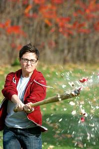 Holly Jackson slams an apple with the baseball bat for Apple Baseball at the High Rock Park for the annual Fall Festival Saturday morning. Photo Erica Miller 10/30/10 fea_FallFest5_Sun