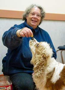 Kim VanDycke, of Broadalbin, practices sitting and eating snacks with Ally in a private room at the new Saratoga County Animal Shelter in Ballston Spa, Saturday marked the Grand Opening. Photo Erica Miller 10/30/10 bspa_AnimalShelter5