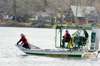 State Forest Rangers search the waters on an air-boat on Galway Lake in search for a missing man who went swimming in the Lake's cold waters on Sunday evening.  Photo Erica Miller 10/31/11 news_GalwayLake3_Tues
