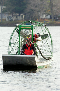 State Forest Rangers search the waters on an air-boat on Galway Lake in search for a missing man who went swimming in the Lake's cold waters on Sunday evening.  Photo Erica Miller 10/31/11 news_GalwayLake4_Tues
