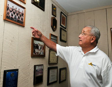 Marty Sherman, former Corinth wrestling coach, show off some of his former awards and photographs, this weekend he will be inducted into the National Wrestling Hall of Fame. Photo Erica Miller 9/25/09 Spt_Sherman2_Sat