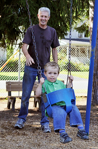 Grandfather Neil McGaughan, of Saratoga, pushes 2 year old Jack Conners at the East Side Recreational Park after promising him today that they would go to the park after school, where he attends the Waldorf School, around the corner on Lake Ave. Photo Erica Miller 9/24/09 news_Park1_Fri
