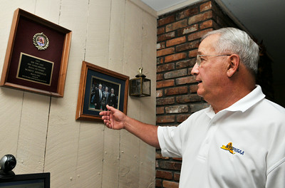 Marty Sherman, former Corinth wrestling coach, points out his Hall of Fame award give to him, where this weekend he will be inducted into the National Wrestling Hall of Fame. Photo Erica Miller 9/25/09 Spt_Sherman1_Sat