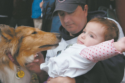 Charleotte, 14 months old, and father Larry Gill, of Delmar, pet a dog before the the 1st annual Saratoga Stroll for Epilepsy at the Saratoga Spa State Park Sunday morning. Photo Erica Miller 9/27/09 news_Epilepsy3_Mon
