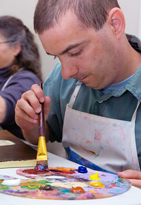 Joey Giannone, of Malta, blends his brown blue and red to make the perfect shade of purple for his vase to paint Monday afternoon at the Creative Endeavors Arts Center on 49 Front Street in Ballston Spa. Photo Erica Miller 9/28/09 news_Creative2_Tue