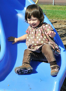 17 month old Julia DiNallo, of Gansevoort, enjoys her thrill-full slide at the East Side Recreational Park Thursday afternoon. Photo Erica Miller 9/24/09 news_Park2_Fri