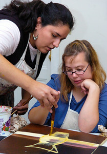 Instructor Winnie Pino, of Saratoga, helps Shannon Meers, of Wilton, with her painting Monday afternoon at the Creative Endeavors Arts Center on 49 Front Street in Ballston Spa. Photo Erica Miller 9/28/09 news_Creative1_Tue