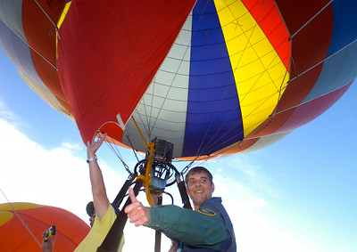 Balloon pilot Harry Collison of Pennsylvania gives a thumbs up as he lifts off Thursday from Crandall Park in Glens Falls during the opening day of the Adirondack Hot Air Balloon Festival. Ed Burke 9/24/09