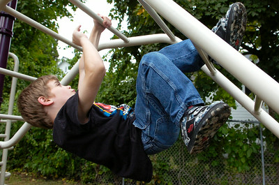 Gavin Merton, 7 years old of Saratoga, climbs around on the bars at the South Side Recreation Park Monday afternoon. Photo Erica Miller 9/28/09 news_Hanging_Tue