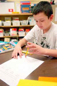 "Fifth grader Dylan Barrera works on ""word work""  in her Literacy Work Station at Ballard Elementary. Photo Erica Miller 10/1/10 wg_LiteracyWork4"